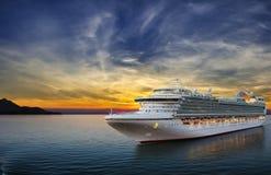 Cruise ship sailing to port. Luxury cruise ship sailing to port on sunset stock image