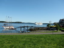 Cruise ship sailing towards Bar Harbor USA. While Margaret Todd is awaiting for its tourists. nnMargaret Todd was designed by her owner, Steven Pagels, and Stock Photos