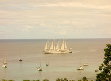 A cruise ship with sails unfurled at admiralty bay Royalty Free Stock Image