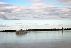 Cruise ship sails on the Volga river. Autumn nature. Stock Photo