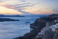 Cruise Ship in Santorini Greece around sunset Stock Images