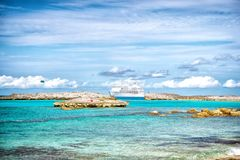 Cruise ship in sea in Great stirrup cay, Bahamas on sunny day. Ocean liner in turquoise water on blue sky. Summer vacation on cari. Bbean. Wanderlust, travelling Stock Photography