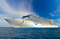 Cruise ship at sea. Large beautiful cruise ship at sea and nice cloudy sky on background Royalty Free Stock Images