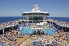 Cruise Ship At Sea. Cruise ship on its way to Bermuda as passengers enjoy the pool Royalty Free Stock Photos