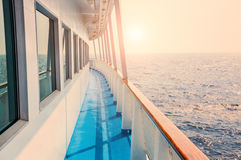 Cruise ship in sea at sunset Stock Photo