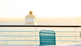Cruise ship over railing. Cruise ship in seas over deck railing with chair Stock Photography