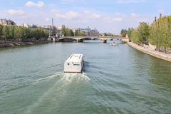 Cruise ship on the Seine river in Paris Royalty Free Stock Images