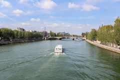 Cruise ship on the Seine river in Paris Royalty Free Stock Image
