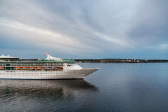 Cruise Ship Setting Sail Under Grey Skies Royalty Free Stock Photography