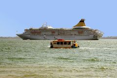 Cruise ship on Sicilian Sea. A view across a bay to a large cruise ship on the Sicilian Sea Stock Images
