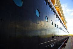Cruise ship. Side of a luxurious and big cruise ship Stock Image