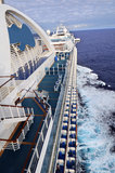Cruise Ship From Side View. Large cruise ship traveling in open seas Royalty Free Stock Photos