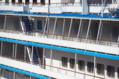 Cruise ship side view closeup as background, window and balcony Royalty Free Stock Image
