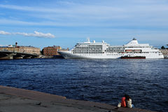 Cruise ship Silver Whisper in St. Petersburg, Russia. St. Petersburg, Russia - June 23, 2015: Cruise ship Silver Whisper anchored at English Embankment. The Stock Photo