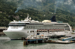 Cruise ship in Skagway, Alaska harbor. Cruise ship moored in Skagway, Alaska harbor royalty free stock photography