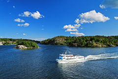 Cruise ship among the skerries of Sweden Stock Photography