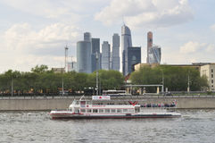 Cruise ship and skyscrapers in Moscow Royalty Free Stock Photos