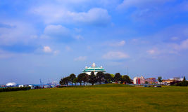 Cruise ship in Southampton, England. Cruise ship along banks near park in Southampton, England on sunny day with blue skies stock image
