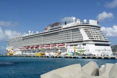 Cruise ship in St. Maarten. Philipsburg, St. Maarten - September 09, 2014: Norwegian Getaway, a cruise ship of Norwegian Cruise Line, anchored at Philipsburg Royalty Free Stock Photo
