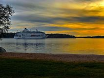 Cruise ship in Stockholm Archipelago sunset royalty free stock image