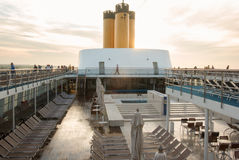 Cruise ship at sunrise. Passengers on deck cruise ship enjoying the sunrise stock images