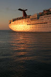 Cruise ship at sunset. Huge cruise ship shining in the evening sun Stock Photos