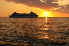 Cruise Ship At Sunset Stock Images