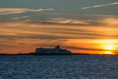 Cruise ship on sunset in Baltic sea. Estonia, Tallinn, center of town, view from Pirita district sea side. Summer time. Golden sunset Royalty Free Stock Photography