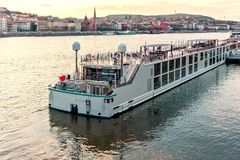 Cruise ship at sunset on Danube river stock photography