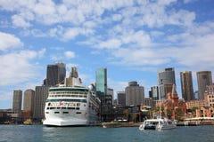 Docked cruise ship in Sydney skyline royalty free stock photography