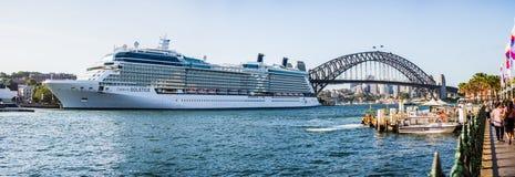Cruise ship and Sydney Harbor Bridge Stock Image