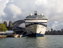 Cruise ship and Sydney Harbour Bridge, Australia Royalty Free Stock Photography