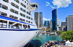 Cruise ship and Sydney skyline. Royalty Free Stock Images