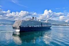 Cruise ship taking off Vancouver port. Royalty Free Stock Images
