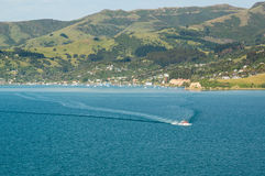 Cruise ship tender leaving Akaroa Harbour NZ Stock Photo