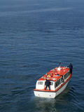 Cruise ship tender at sea. High angle view of cruise ship tender boat sailing in blue sea stock photo