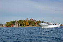Cruise ship in Thousand Islands, New York, USA. Cruise ship Grande Mariner at Boldt Castle on Heart Island, Thousand Islands on St. Lawrence River, New York royalty free stock image