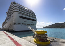 Cruise ship tied to steel bollard Stock Photo