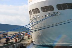 Cruise ship tied up in port stock photos
