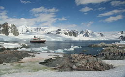 Cruise ship & tourists. Amid icebergs & glaciersPetermann Island,Antarctica Stock Images