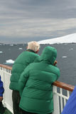 Cruise ship tourists looking at glaciers Stock Photo