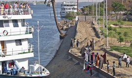 Cruise ship with tourists and merchants at the rive Nile. Cruise ship with tourists and merchants at Edfu on the bank of the river Nile, Egypt stock photos