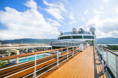 Cruise ship. Tourists relax and take a sun bath on the upper dec Royalty Free Stock Photo