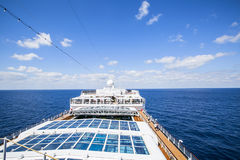 Cruise ship. Tourists relax and take a sun bath on the upper dec Stock Images