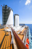 Cruise ship. Tourists relax and take a sun bath on the upper dec Stock Photography