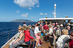 Cruise ship with tourists visiting the Aeolian Islands at Sicily, Italy Stock Photography