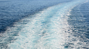 Cruise ship trails in open sea Royalty Free Stock Photos