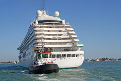 Cruise ship for the transportation of passengers pulled by Royalty Free Stock Photography