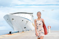 Cruise ship travel woman going shopping in port. Cruise ship travel going shopping in port on travel cruise vacation at sea. Happy mixed race Asian Chinese Stock Photo
