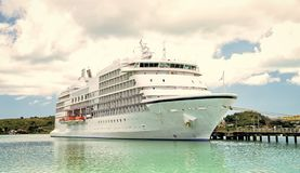 Big cruise ship, white luxury yacht in sea port, Antigua. Cruise ship. traveling and adventure, big cruise ship, beautiful white yacht, luxury modern cruise ship stock images